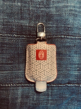 Load image into Gallery viewer, Khaki Geo Printed Sanitizer Holder - Faux leather with refillable bottle.
