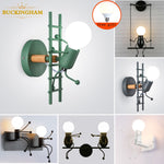 Laden Sie das Bild in den Galerie-Viewer, Nodic Wall Lamp Creative Small Man Iron Lights Metal Simple Cartoon Robot Sconce Lamps For Indoor Art Decor Light