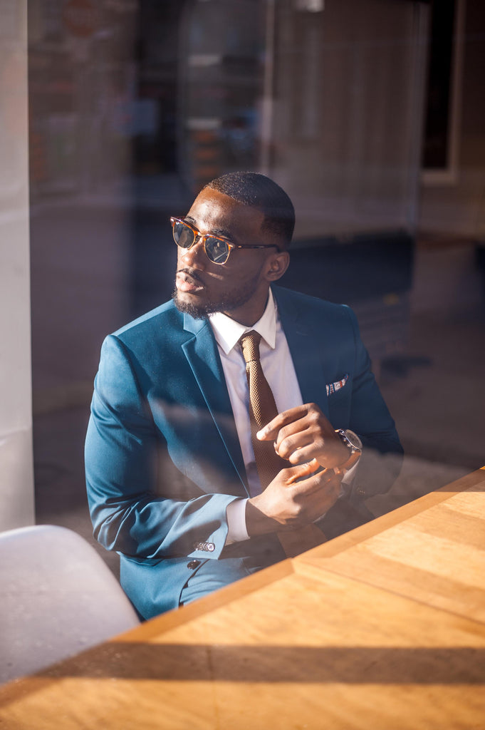 Jesse Aboagye Teal Suit and Brown Knit Tie Look 2
