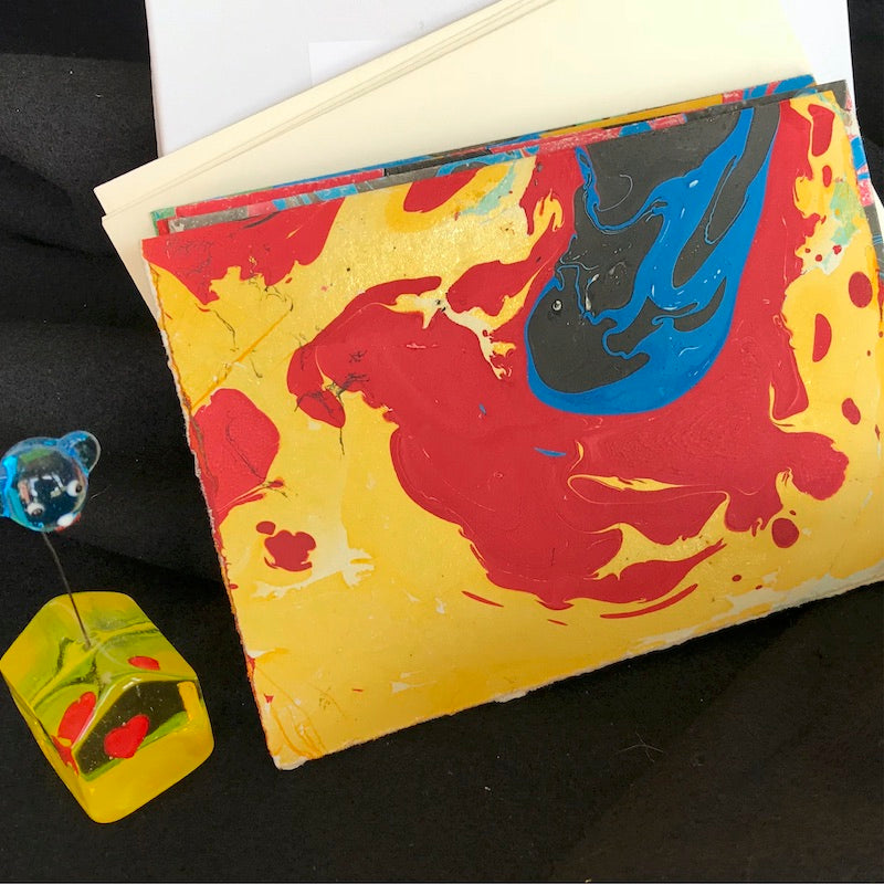 hand-marbled note card, yellow, red, blue, black