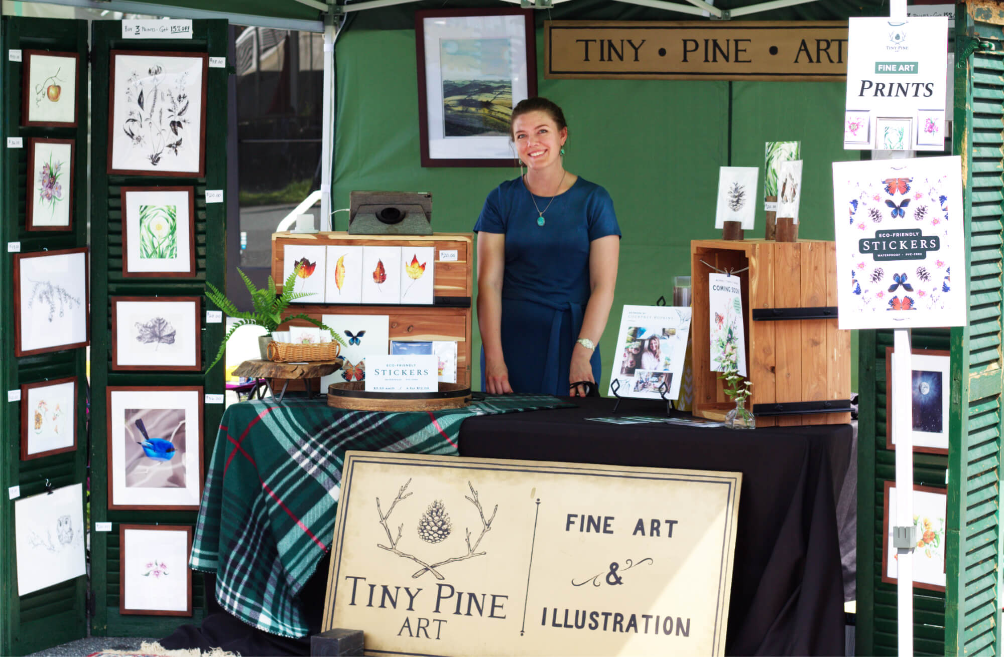 Courtney Hopkins in her Tiny Pine Art booth