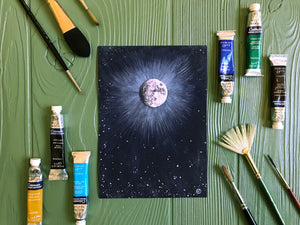 Light Of The Full Moon print on table with art supplies