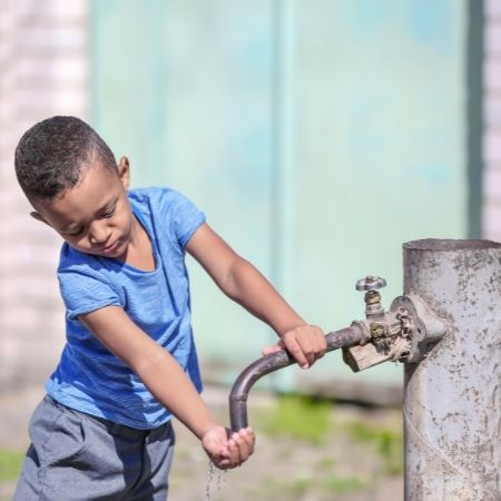 Child collecting water