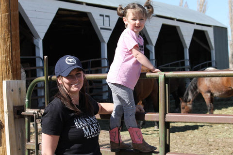 Kari and daughter Evalyn checking on their horses