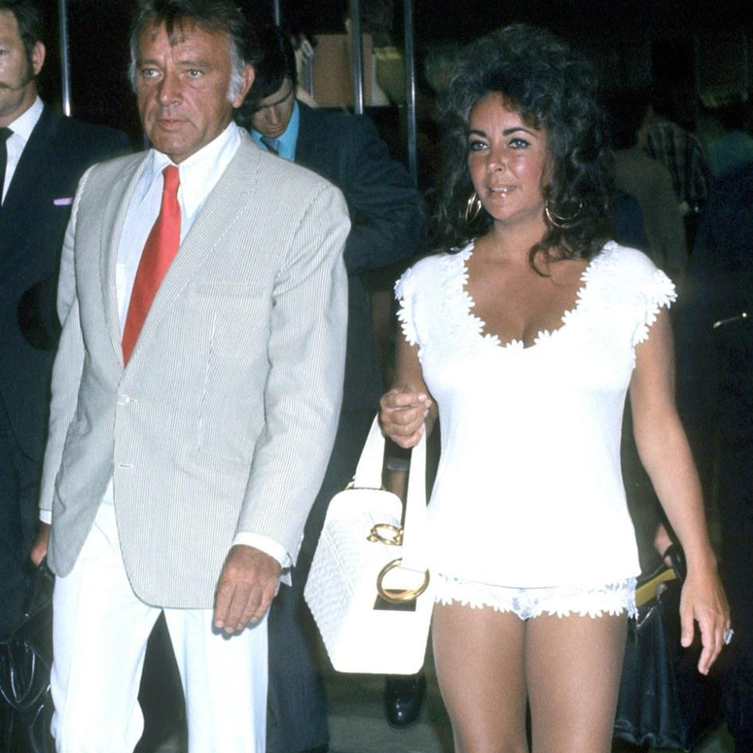 Elizabeth Taylor wearing daisy applique white shorts and matching top leaving airport