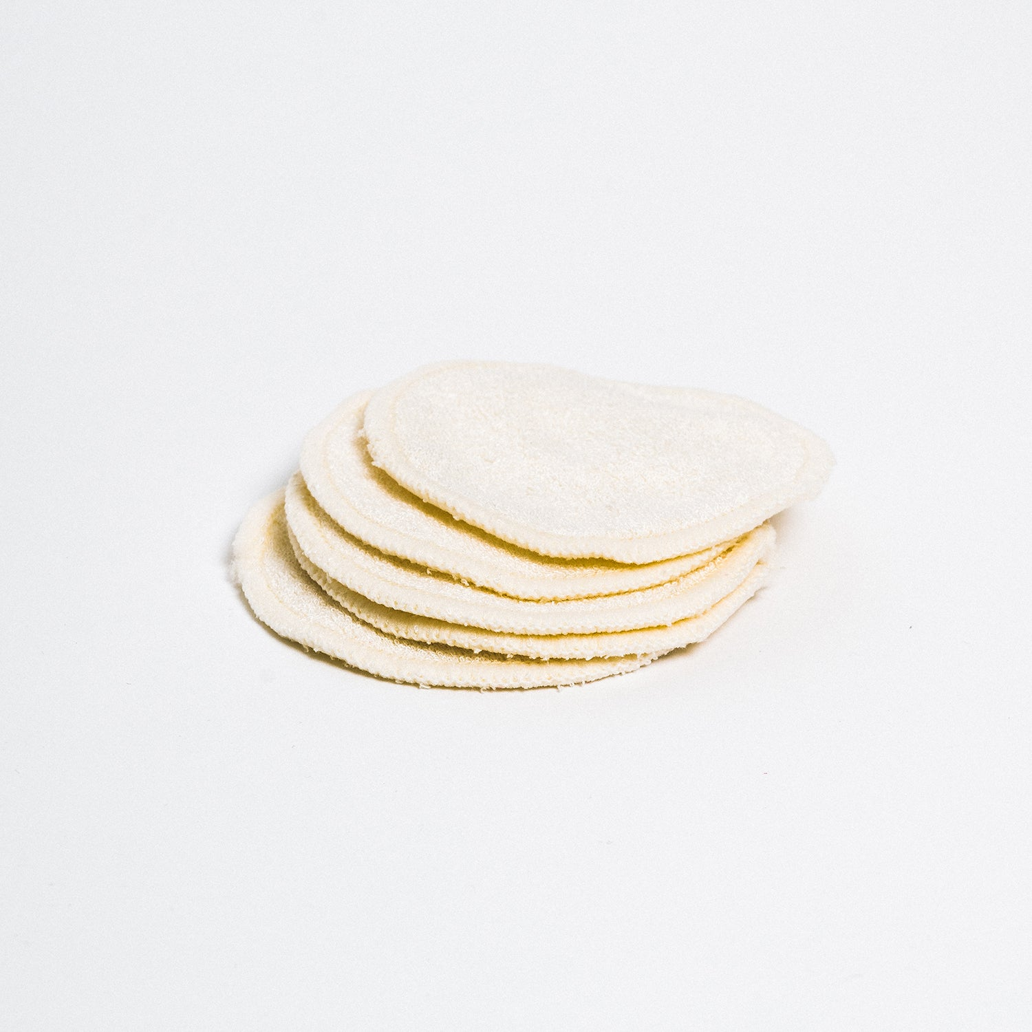 A stack of reusable fabric cotton rounds.