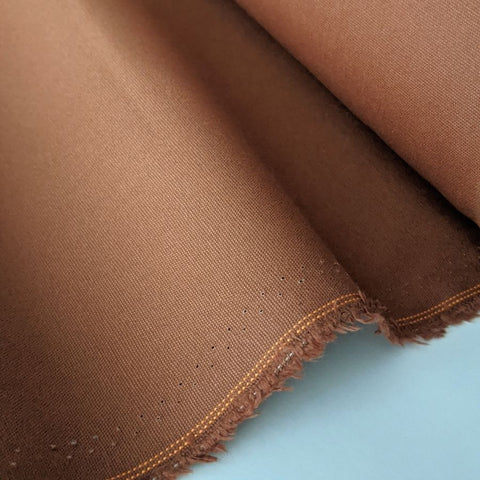 dry wax cotton fabric in rust