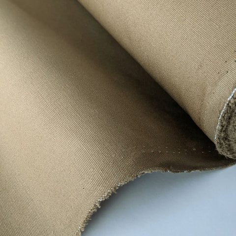 dry wax cotton fabric in sand