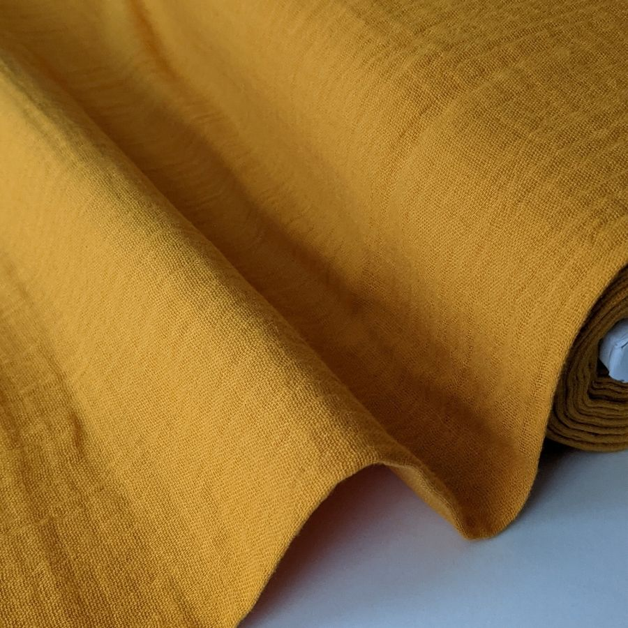 Mustard double gauze fabric close up view