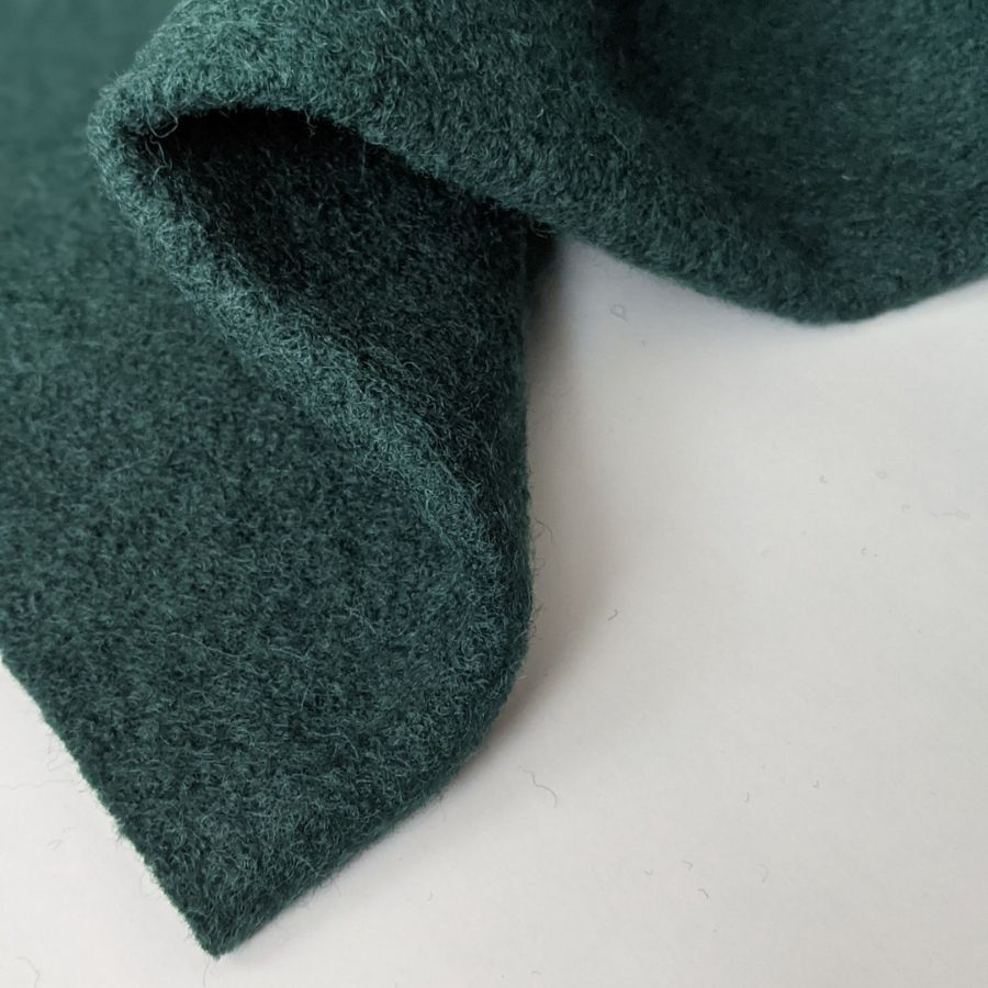 Wool boucle in dark green little corner view
