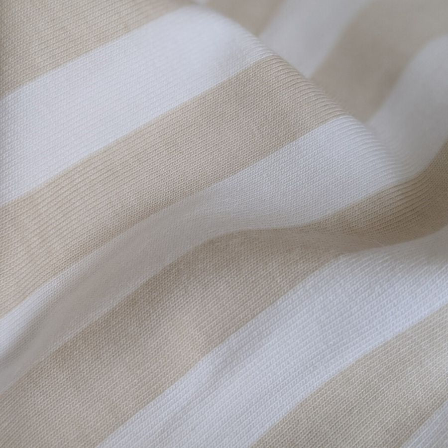 Tygdrommar cotton jersey vertical lines sand zoomed in view