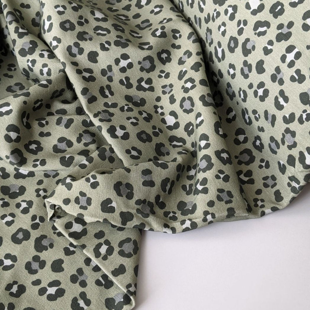 Animal print cotton french terry in sage scrunched up view