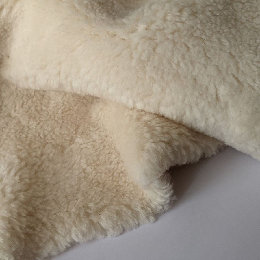 Organic cotton plush fabric in cream zoomed in