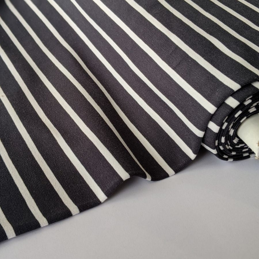 Good Fabric organic stripe jersey in dark grey and white close up view