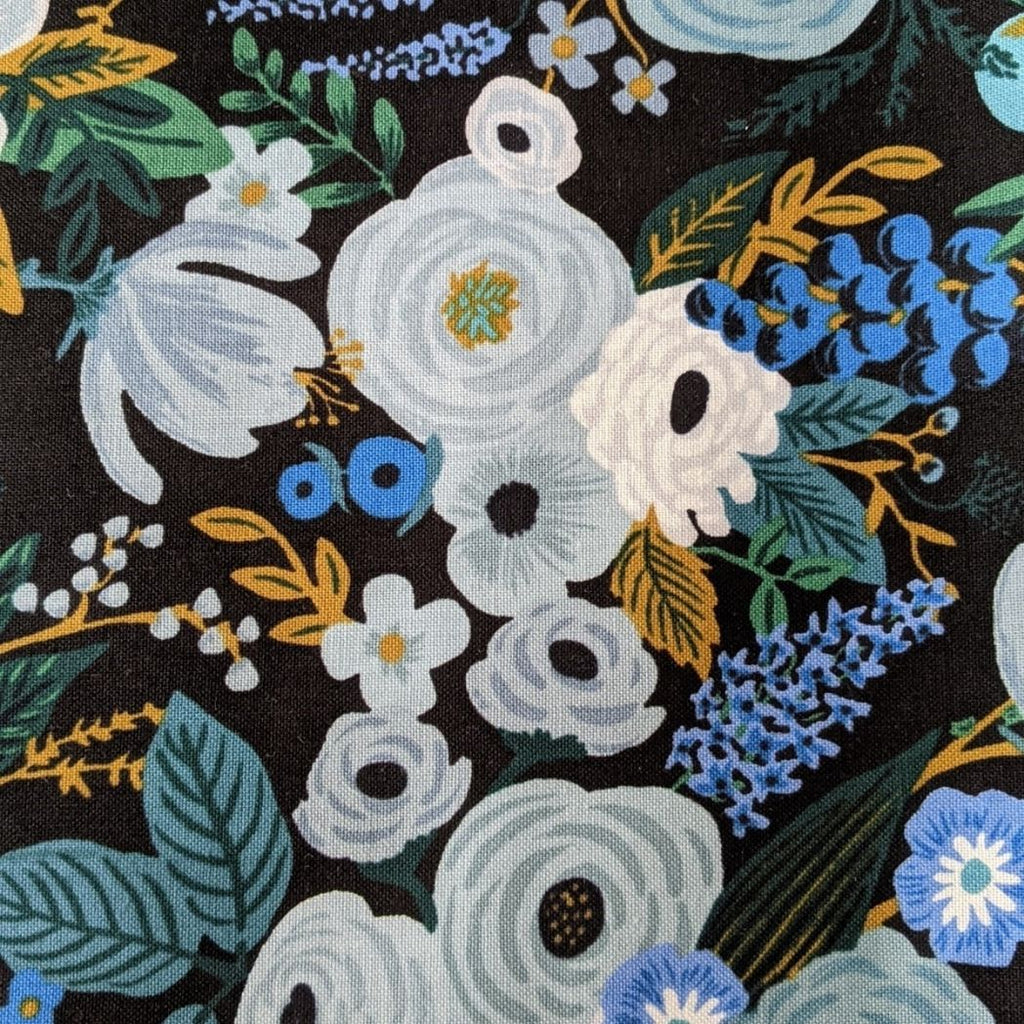 Rifle Paper cotton fabric garden party print in blue close up view