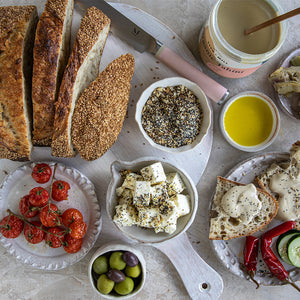 Mezze platter, featuring Seed + Mill Spice Blends. Liven up olive oil, feta cheese, crusty bread with some Seed + Mill goodness!