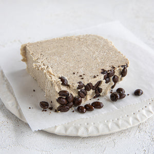 A plated slice of Seed + Mill Coffee Halva. Gluten-free, dairy-free, and vegan. Crumble into granola, cookies, yogurt, or melt on toast!