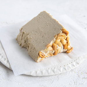 A plated slice of Seed + Mill Crunchy Peanut Butter Halva. Gluten-free, dairy-free, and vegan. Crumble into granola, cookies, yogurt, or melt on toast!