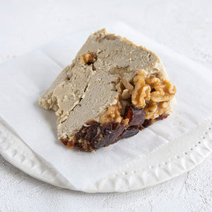 A plated slice of Seed + Mill Date Walnut Halva. Gluten-free, dairy-free, and vegan. Crumble into granola, cookies, yogurt, or melt on toast!
