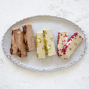 A plated assortment Seed + Mill halva flavors also available in 8 oz packages. Search for our 'Halva Trio' to get your Sea Salt Dark Chocolate, Pistachio, and Raspberry halva. Gluten-free, dairy-free, and vegan.