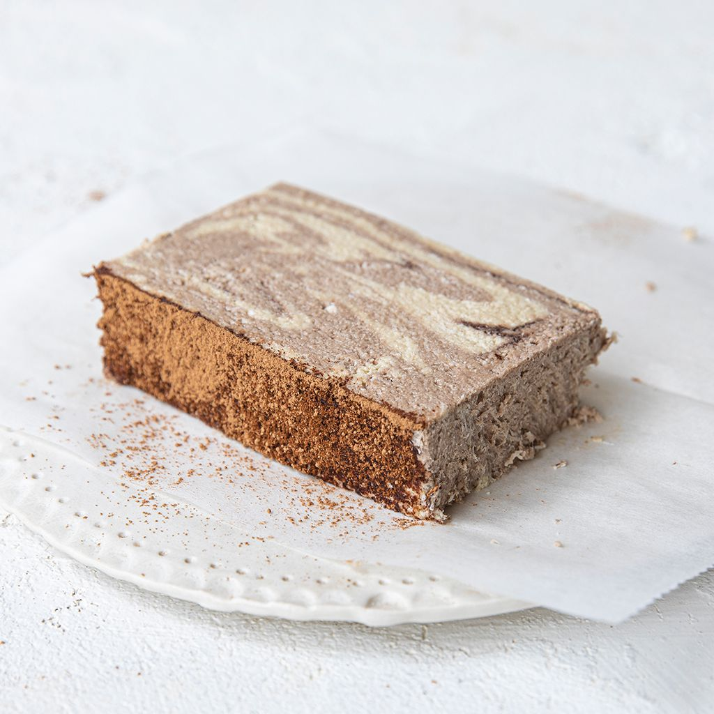 A plated slice of Seed + Mill Marble Halva. Gluten-free, dairy-free, and vegan. Crumble into granola, cookies, yogurt, or melt on toast!