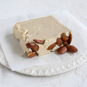 A plated slice of Seed + Mill Marzipan Halva. Gluten-free, dairy-free, and vegan. Crumble into granola, cookies, yogurt, or melt on toast!