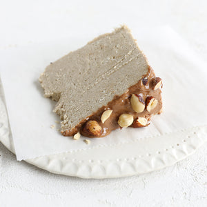 A plated slice of Seed + Mill Nougat Halva. Gluten-free, dairy-free, and vegan. Crumble into granola, cookies, yogurt, or melt on toast!