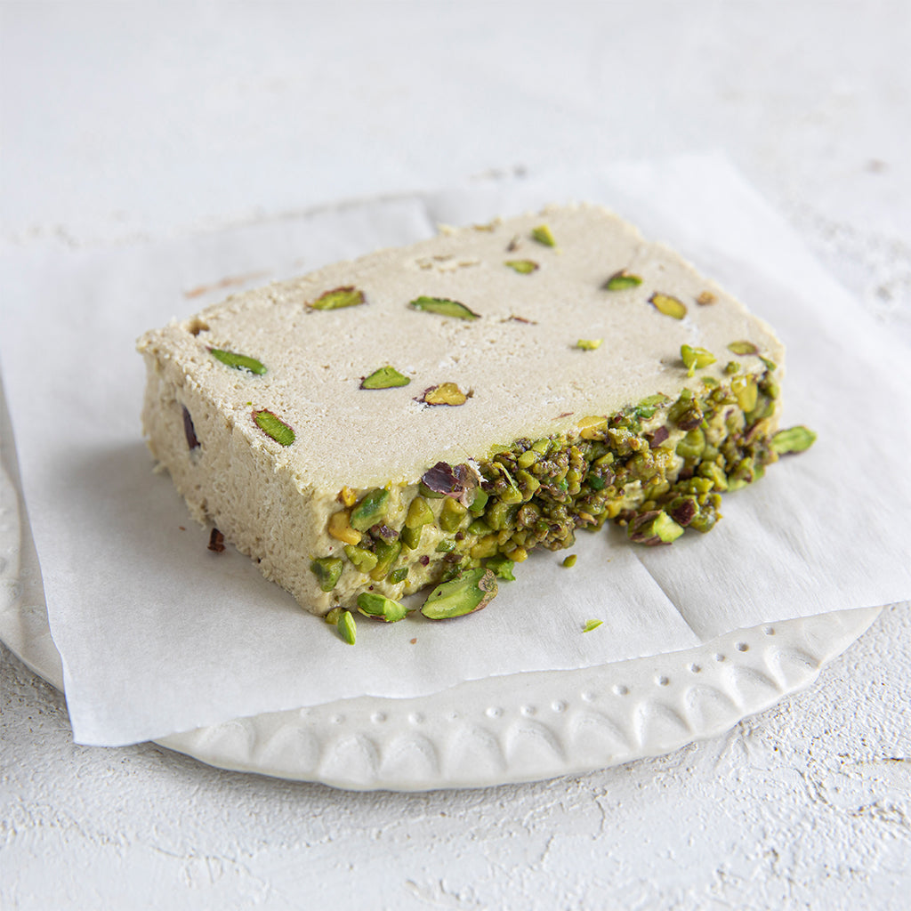 A plated slice of Seed + Mill Pistachio Halva. Gluten-free, dairy-free, and vegan. Crumble into granola, cookies, yogurt, or melt on toast!