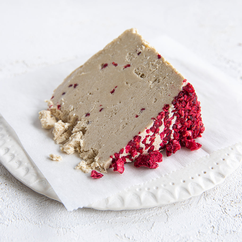 A plated slice of Seed + Mill Raspberry Halva. Gluten-free, dairy-free, and vegan. Crumble into granola, cookies, yogurt, or melt on toast!
