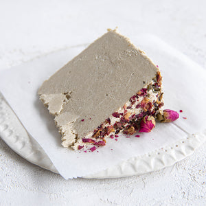 A plated slice of Seed + Mill Rose Halva. Gluten-free, dairy-free, and vegan. Crumble into granola, cookies, yogurt, or melt on toast!