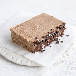 A plated slice of Seed + Mill Sea Salt Dark Chocolate Halva. Gluten-free, dairy-free, and vegan. Crumble into granola, cookies, yogurt, or melt on toast!