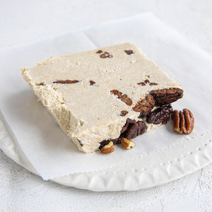 A plated slice of Seed + Mill Sweet Pecan Halva. Gluten-free, dairy-free, and vegan. Crumble into granola, cookies, yogurt, or melt on toast!