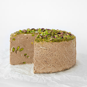 Available in 6.6 lb rounds. Seed + Mill Chocolate Pistachio Halva. Gluten-free, dairy-free, and vegan. Whole cake serves approx. 40-45 hungry guests! Buy a whole cake and add some excitement to any celebration!
