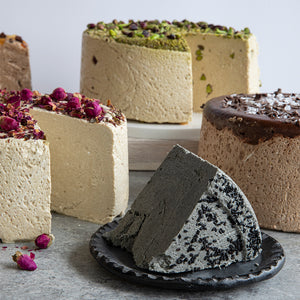 An assortment of our top flavors: Choclate Orange, Rose, Pistachio, Sea Salt Dark Chocolate. Featuring a plated slice of Black Sesame Halva. See our 'Create a Gift' page to put together something special for that special someone! Gluten-free, dairy-free, and vegan.