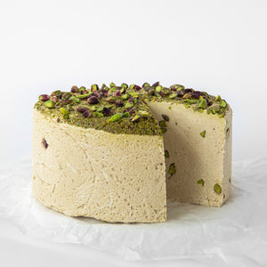Available in 6.6 lb rounds. Seed + Mill Pistachio Halva. Gluten-free, dairy-free, and vegan. Whole cake serves approx. 40-45 hungry guests! Buy a whole cake and add some excitement to any celebration!