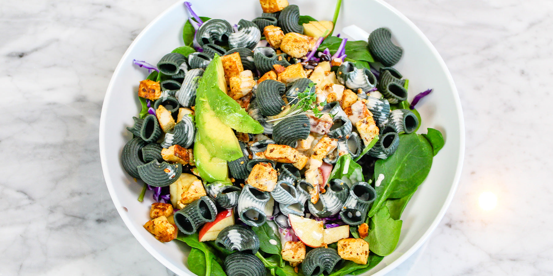 White Corn and Spirulina Pipe Rigate Salad with Crispy Tofu and Yogurt Vinaigrette