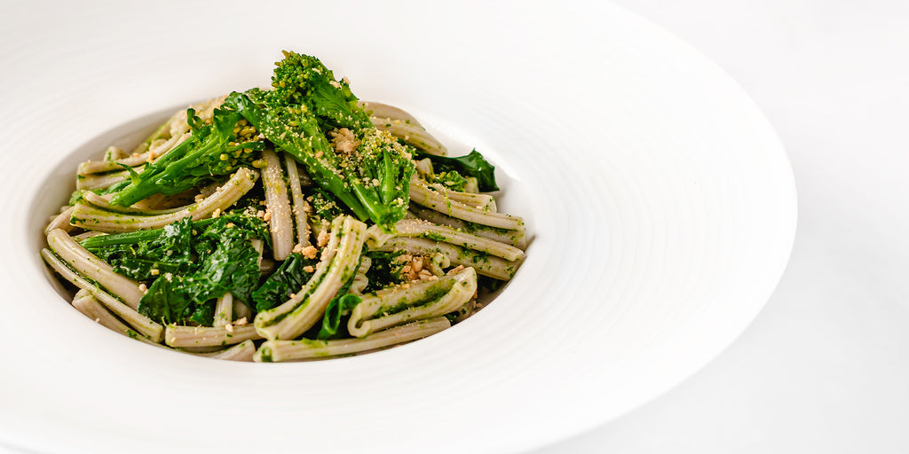 Plate of Sorghum Casarecce with Turnip Greens and Taralli Breadcrumbs