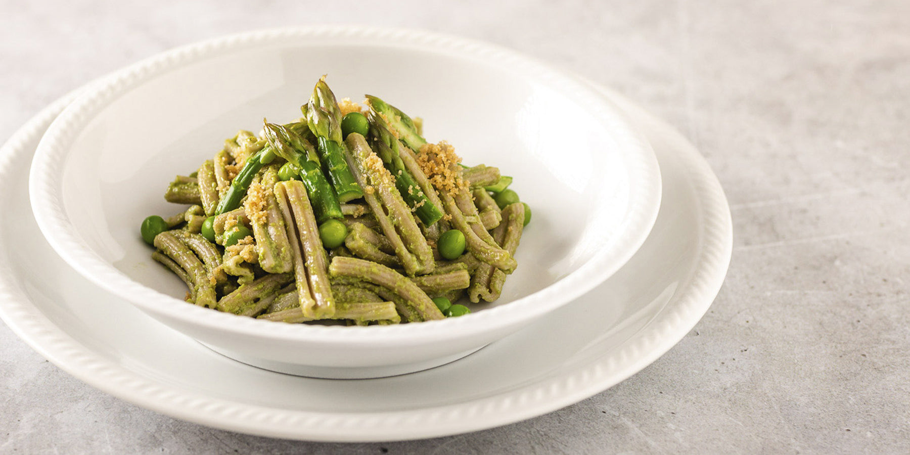Plate of Sorghum Casarecce with Peas, Asparagus and Garlic Breadcrumbs