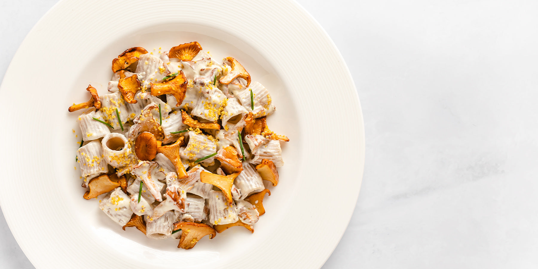 Plate of Baked Sorghum Mezze Maniche with Chanterelles