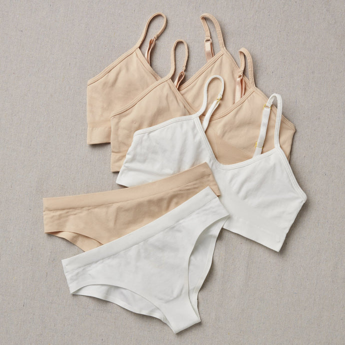 This Fab Five Bundle includes 3 Chickadee Girls first Bras (two in Doe [tan], one in Snowflake [white]) and 2 pairs of Twistr Underwear (one in Doe [tan], one in Snowflake [white]).