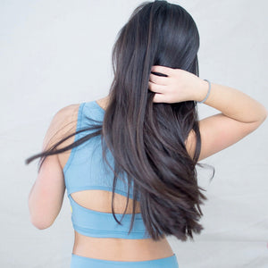 Girl wearing NEW Hula Crop Bra in Pebble (Blue-gray)