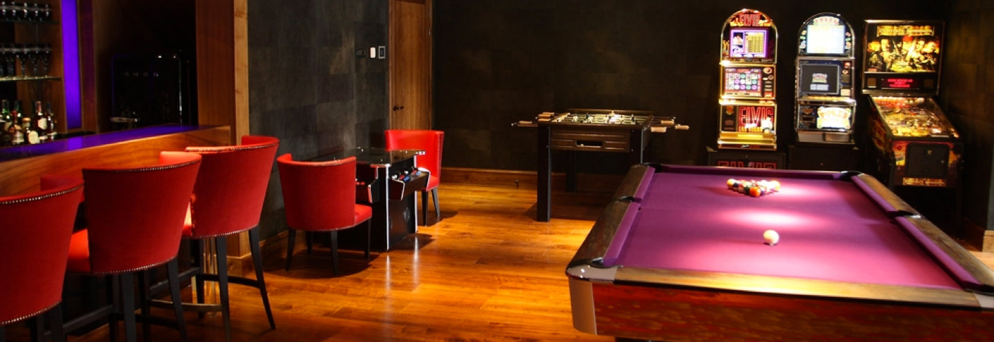A luxury games room in Hertfordshire showcasing a bespoke copper pool table