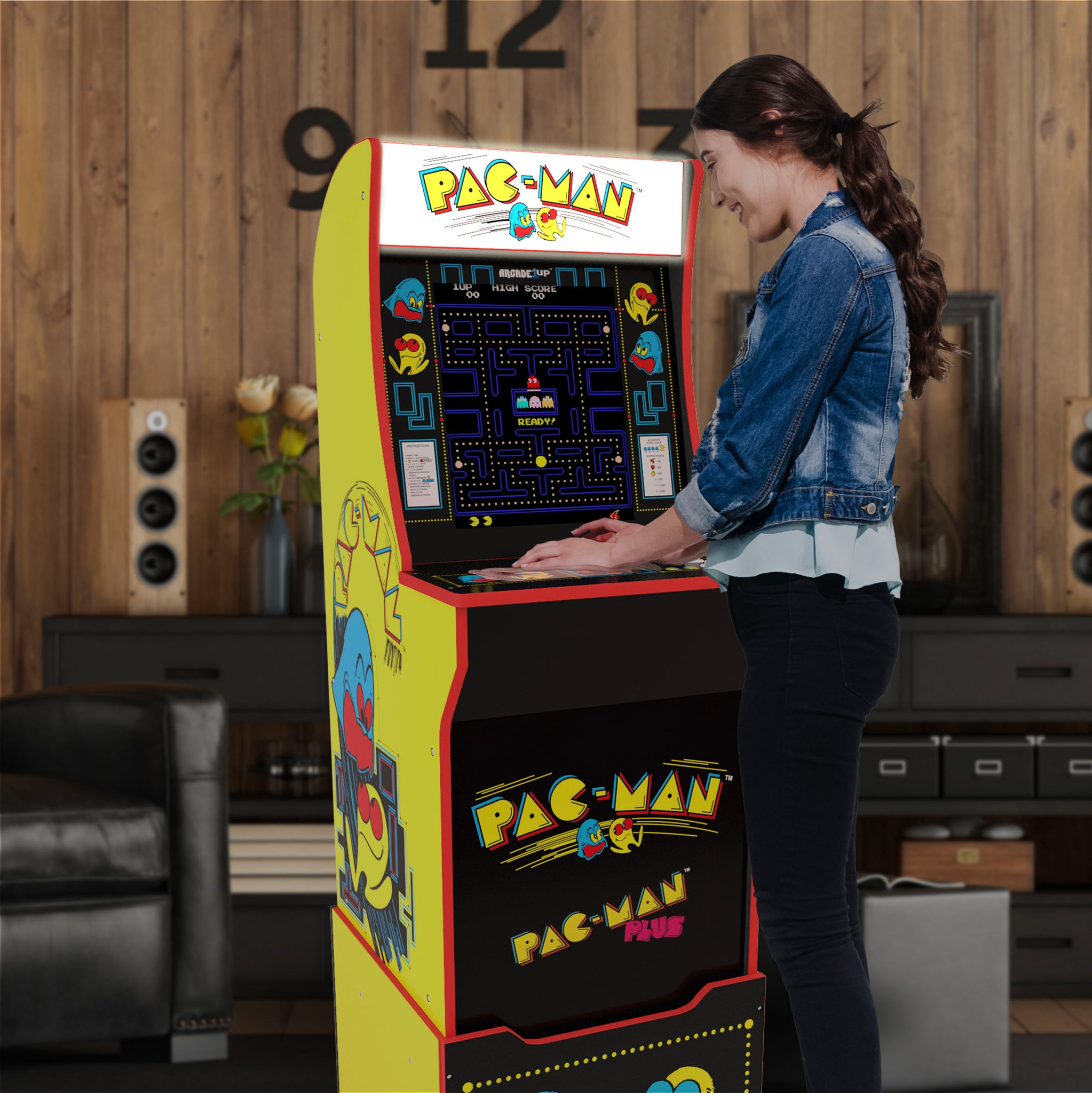 Pac-Man Arcade Machine includes illuminated top marque, riser and stool
