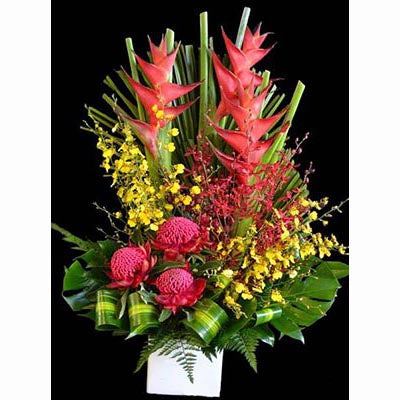 Bright colorful tropical flowers arrangement heliconias crab claws red banksias