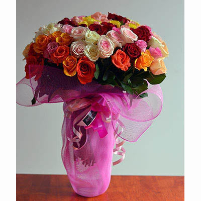 Mixed coloured roses bouquet tall vase