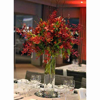 Red James Storey orchids lilies table tall centerpiece