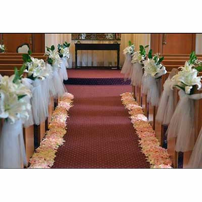 Wedding ceremony flowers pews rose petals