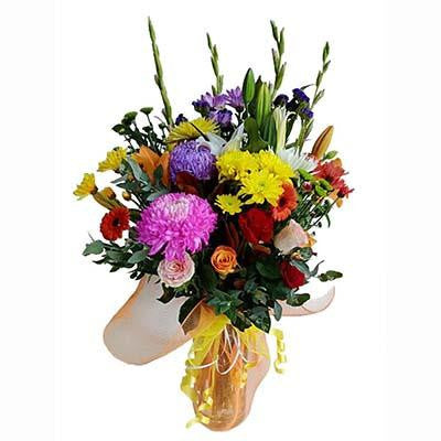 Bright colorful flower large bouquet glass cylinder vase