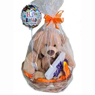 Gift wrapped hamper teddy bear Lindt chocolates balloon
