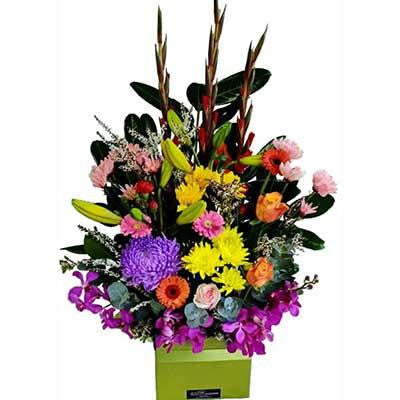 Large bright colorful flowers modern arrangement gift box